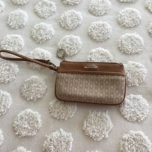 Fossil tan and beige wristlet.